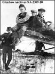 W.H. Waddell, surveyor, second from left, on Imperial Oil company aircraft on test flight re Arctic transportation.