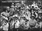 L-R second row: unknown; unknown; Maggie Fry; Johnny J. Jones; Lillie Fry; Goldie Terrill. + L-R front row: Minnie June, cowgirl; Eliza Wood, cowgirl. + Event on 7th Avneue SW between 1st SW and Centre Street.