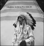 Taken at Calgary Exhibition and Stampede. Calgary, Alberta. He operated a coal mine on the banks of the Bow river. A member of six Blackfoot societies, custodian of three medicine pipes, an authority on Blackfoot traditions. Possibly Boy Chief. See + NA-667-110