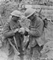 Photograph of two Canadians examining a skull, Vimy Ridge, April 1917